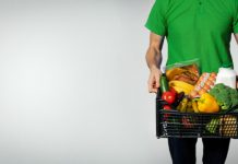 a man holding grocery basket