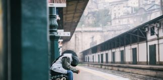 A man alone waiting at the train station