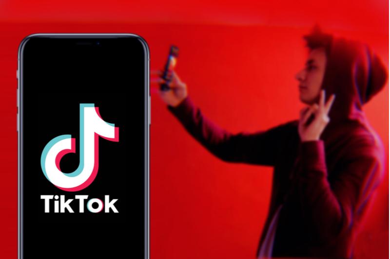 teenage boy using tiktok