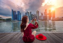 Woman taking photo of Singapore Skyline