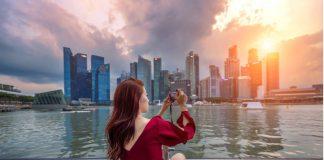 Woman taking photo of Singapore Skyline