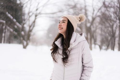 Woman in snow happy