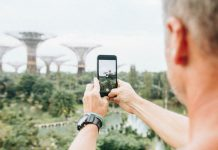 A man taking photo of Gardens by the Bay in Singapore