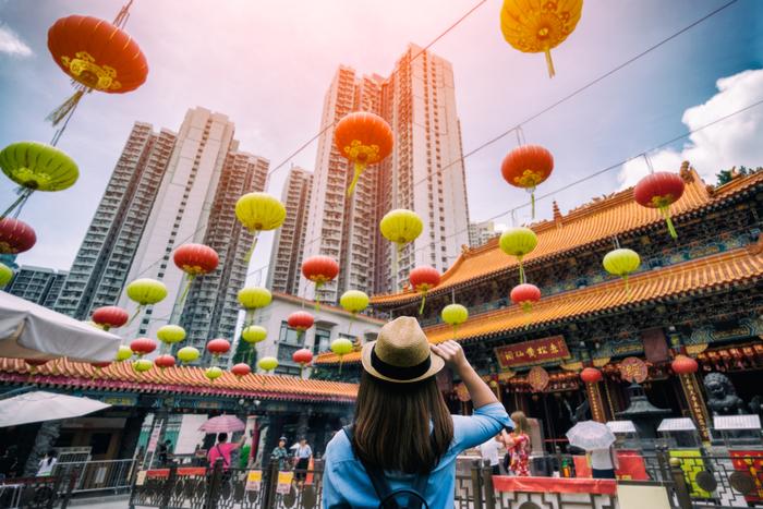 Woman visiting Wong Tai Sin temple in Hong Kong