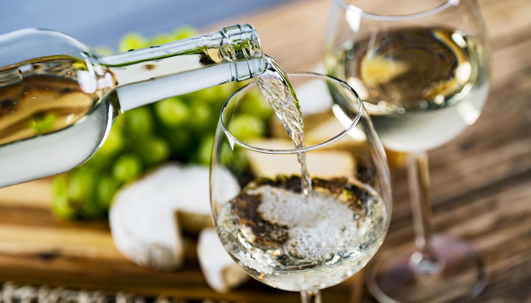white-wine-pour-into-a-glass