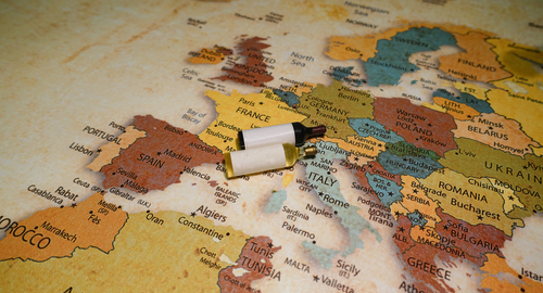 Wine,Bottles,On,A,Map,Of,Europe.