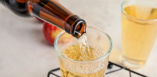 Pouring,Of,Apple,Cider,Into,Glass,On,Table