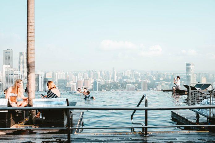 sky,swimming pool, blue,women,tourist